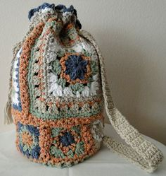 http://www.etsy.com/listing/90879080/crochet-extra-large-granny-square-tote?ref=sc_6