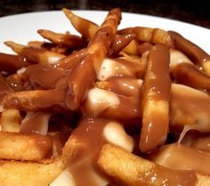 Poutine!  Yes please!  Hot fries covered with melty cheese curds and hot brown gravy!
