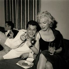 "A rare behind the scenes shot of Hollywood legends' Marilyn Monroe and Tony Curtis sharing a meal during filming of the 1959 comedy classic, ""Some Like It Hot!"""