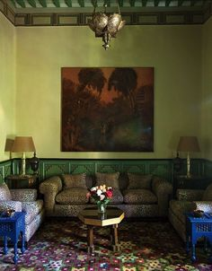 Yves Saint Laurent and Pierre Bergé's Villa Oasis in Marrakech...brass ceiling pendant...Chartreuse green walls, leopard sofa & chairs...