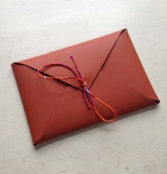 Physical envelope and thank you note in leather and silk from Hermes. Beautiful concept and execution.