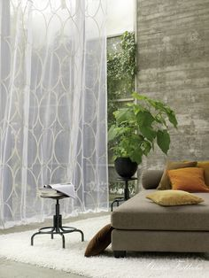 It's all about the sheer fabric... http://www.decorteamus.com/