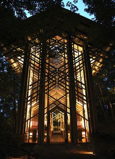 Nestled in a woodland setting, Thorncrown Chapel rises forty-eight feet into the Ozark sky. This magnificent 48' tall wooden structure contains 425 windows and over 6,000 square feet of glass. It sits atop over 100 tons of native stone and colored flagstone.   Thorncrown was the dream of retired school teacher, Jim Reed and w architect E. Fay Jones design a place of worship for the visitors to Eureka Springs, Arkansas.