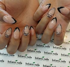 Nude and black stilletto nails. Perfect classy manicure.