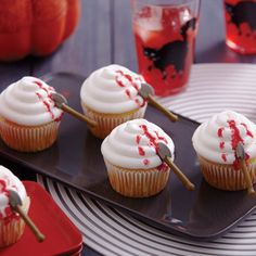 Battle Axe Cupcakes from @michaelsstores.  Startle Halloween party guests with cupcakes that look gruesome but taste yummy! Make them using Wilton® Battle Axe Royal Icing Decorations and Wilton Blood Red Sparkle Gel.