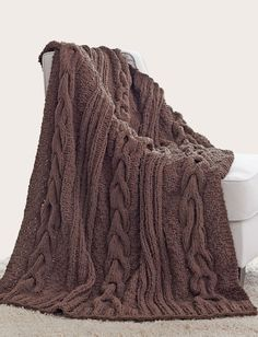 Yarnspirations.com - Bernat Horseshoe Cable Blanket - Patterns  | Yarnspirations | Deep, horseshoe cables in a strong shade add a warm and inviting feel to your room. Shown in Bernat Blanket.