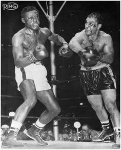 HIGH DRAMA: Rocky Marciano's perfect record was never in more jeopardy than it was in this RING Fight of the Year against Ezzard Charles on Sept. 17, 1954 at Yankee Stadium. A cut on Marciano's nose was so severe that the fight was in danger of being stopped in the middle rounds. The champ responded by putting Charles down twice in the eighth, the second time for a 10-count. Marciano was losing badly on the cards at the time of the stoppage.