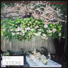 This floral chandelier made with sand blasted manzanita, garden roses and peonies create a gorgeous centerpiece for a rustic wedding! Rustic elegance is the perfect way to describe this! #gardeninspired
