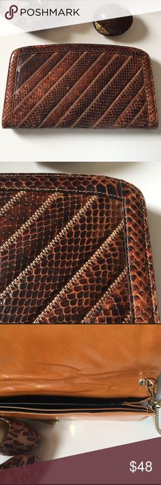 LARGE BROWN SNAKESKIN CLUTCH/BAG WITH STITCHING Large brown amber color snakeskin bag with single large link chain that can also be ticked away for clutch use. There are a marks on the inside leather from the chains pressing which is not uncommon. There are three divided compartments, front single snap closure, clean fabric lining with very little wear of significance. A few of the scales have flaked on in a few spots leaving an opaque look. A spot of amber color nail polish would address…