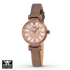 A scrumptious array of Chocolate Diamonds® decorates the center of the dial and lines the bezel of this Chocolate Deco Rotondo™ watch from Le Vian Time®. The 35.5mm Strawberry Steel® case with Chocolate PVD finish pairs well with the brown satin strap that secures with a buckle. The watch features a quartz movement and is topped by a scratch-resistant sapphire crystal.