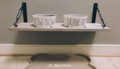 DIY DOG BOWL STAND: Rae Dunn dog bowls, Hobby Lobby floating shelf with raised screws to hold each bowl in place Dog Food Bowl Stand, Dog Food Stands, Dog Food Bowls, Pet Bowls, Elevated Dog Bowls, Raised Dog Bowls, Dog Corner, Dog Spaces, Dog Rooms