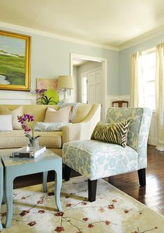 love the soft blue and those tables are great!