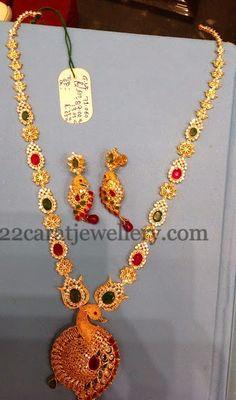 CZ Set with Dancing Peacock Locket - Jewellery Designs