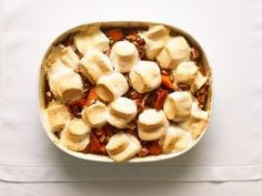 """Sweet Potatoes and Marshmallows : Thanksgiving is the time to embrace nostalgic dishes like sweet potatoes with marshmallow topping. """"When I make this, I feel like a kid in my mom's kitchen. The best part is watching the marshmallows bubble and toast,"""" says Sunny."""