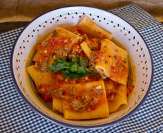 Pasta alla Norcina Rosso - A traditional Umbrian pasta dish made with sausages and cream along with diced fresh tomatoes.