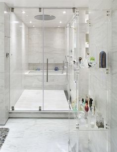Luxurious UN Plaza Apartment Design by ORA Studio: luxurious bathroom shower system with transparent perfume shelves and marble tile also ceiling lamp