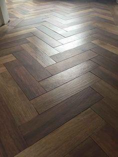 porcelain flooring Dark wood effect porcelain floor tiles laid in a herringbone pattern Wood Floor Stairs, Wood Floor Bathroom, Diy Wood Floors, Wood Floor Kitchen, Wood Parquet, Wood Laminate Flooring, Diy Flooring, Living Room Flooring, Kitchen Flooring