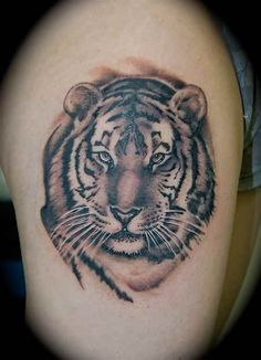 Thigh Tattoo # 83 - Tiger face tattoo on thigh. One of the most sought tattoo idea for thigh:)