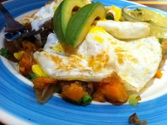 Jerk Pork Belly Hash with Fried Eggs for brunch at Miss Lily's in NYC. So delicious!