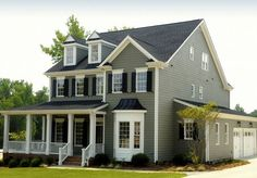 Gray Green with black shutters white trim
