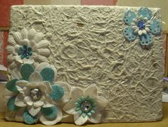 Cover of hand made book I made with felt pages inside for my earring collection