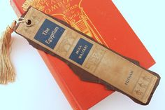 "Leather Book Spine Bookmark Of  ""The Egyptian"" - Beautiful Tassel, Backed With Soft Leather by TheGildedLion on Etsy https://www.etsy.com/listing/234428848/leather-book-spine-bookmark-of-the"