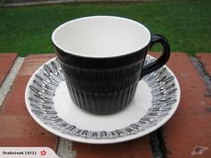 "APOLLO BLACK CUP & ""CORONET"" SAUCER"
