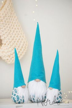 Nordic Gnome turquoise SET of 3 Traditional Christmas gnome gets a fun modern twist with this whimsical color! This Listing is for a set of three gnomes : Large:17 Junior x2 : 11 Each gnome has a turquoise and white fabric body and turquoise felt hat. Soft , white faux fur beard brings a