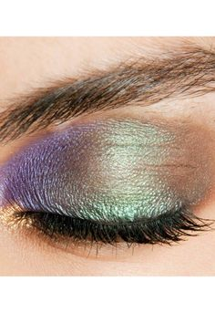 Get peacocking eyes with a brown shadow base and layers of purple and emerald