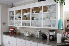 MaI like the idea of some open  cabinetry make me keep the cabnits cleaner and mre organized