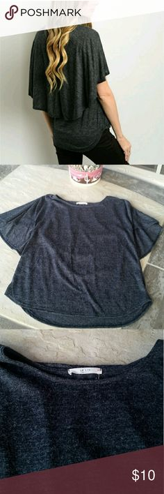 """Dark Gray Top Dark Gray Top. Brand: Le Lis. Size: Large. 80% Polyester, 20% Rayon. When laying flat from top of shoulder to bottom is approximately 24"""" in front, 25"""" in back. Across chest from armpit to armpit is approximately 19"""". No rips, tears, flaws, or defects. Comes from a smoke free home. Final price unless bundled. No trades, no holds, thank you. Le Lis  Tops Blouses"""
