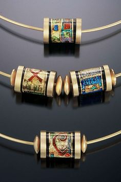 Barrel slider pendants by N. Carolina jeweller James Carter. Gold, cloisonné enamel.