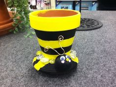 tiny Bumblebee painted pot with seed planted inside to take home.