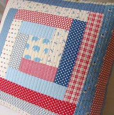 Red, white, and blue log cabin pillow with elephant fabric in the middle