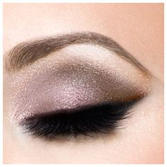 Adding a bit of dark brown over the eyeliner line to give the edge of the eyes a bit of pop, instead of layering on the heavier shadows at the edges.