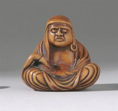 "WOOD NETSUKE 19th Century By Choren. Depicting Daruma seated while holding a hoso. Height 1.75"" (4.5 cm)."