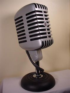 """""""Unidyne"""" by Jeffrey Stephenson. Tribute to the Shure 55 microphone.  It is made of aluminum-painted basswood with a cast iron mic stand."""