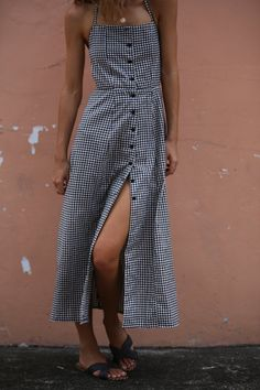 Anyone for Sunday brunch? This is an ankle length button down dress with open back. • Can be tied over arms or around neck as halter • Open back • Fitted bodice • Button down • 100% Cotton • Cold Hand Wash **Model wears size XS