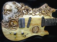 Doug Rowell made many cool carved guitars - this one is Jerry Garcia ...