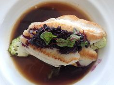 Carolina Flounder with Huckleberries, raised kale, cauliflower and charred leek nage from Spencer's for Steaks and Chops Spring 2013 menu at Hilton Orlando.