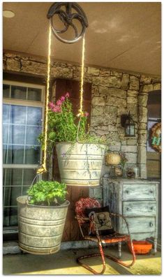 Vintage cast iron pulley is a perfect flower pot holder!