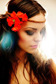 Pretty soft smoked eye makeup and braided headband with flowers. Perfect look for being outdoors and glam