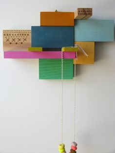 Painted wooden blocks (used here as a jewelry display)