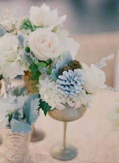 ice blue spray-painted pinecones add the perfect Wintery touch