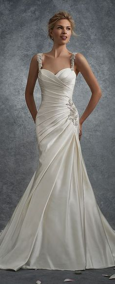Sleeveless soft duchess satin fit and flare gown with crystal encrusted hand-beaded straps, sweetheart neckline, directionally draped bodice with matching beaded accent at hip, asymmetrically dropped waist, back corset, court length train. Also available without beaded straps as Y21738D. Beaded straps sold separately as Y21738STR in Ivory and Diamond White.