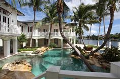 ThisWest Indies-inspired waterfront estate is located at 250 NE 5th Avenue in Boca Raton, FL and is situated on 1. Description from homesoftherich.net. I searched for this on bing.com/images
