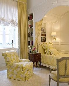 Beautiful bed alcove . . . nice use of space with the built-in bookcase & bedside lighting.
