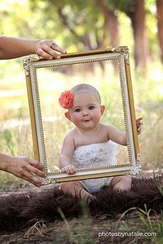 A picture frame used as a photo opt for a 1st birthday party. See more first girl birthday party ideas at www.one-stop-party-ideas.com