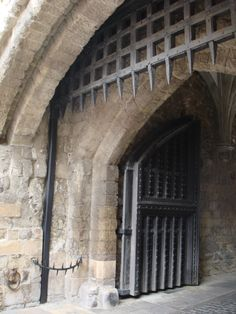 Portcullis, Tower of London  (L.A. Cecil)  This is the 'people' entrance. In case of attack--the iron gate slams down.--.sometimes trapping the invader within. There is another matching iron gate on the other side of the wall.