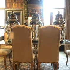 Ginger Jars. #andrewmartin #interiordesign #decor #diningtable #diningchairs #chairs #silver #ginger #jars #reflective